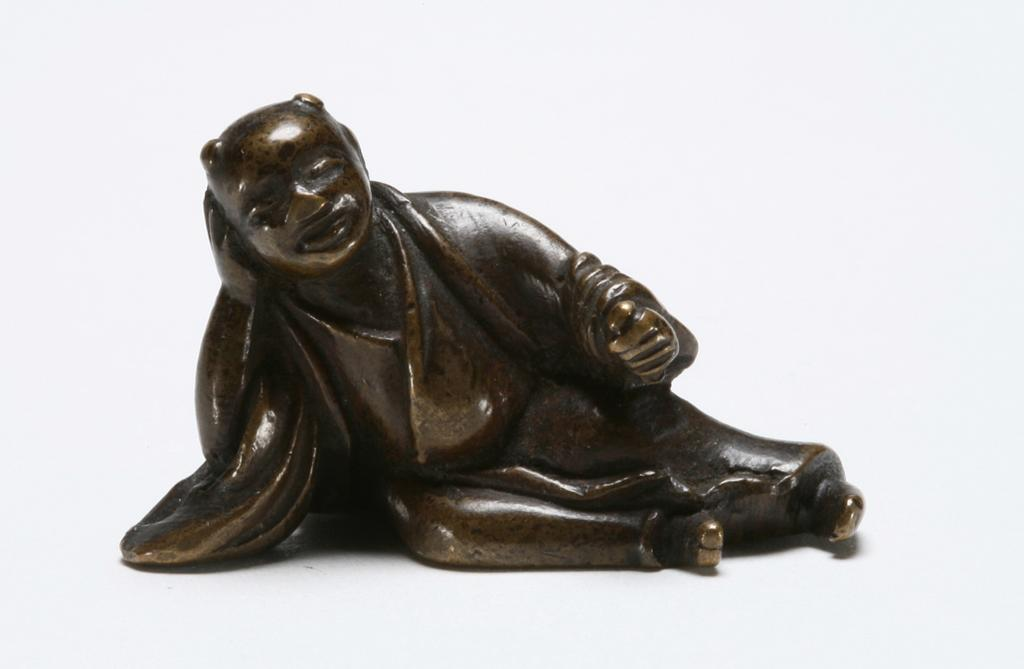 Featured image for the project: Copper alloy netsuke of a sleeping karako