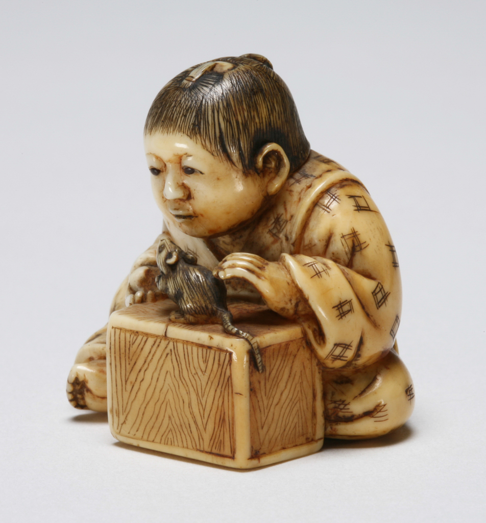 Featured image for the project: A child in a patterned robe playing with a rat